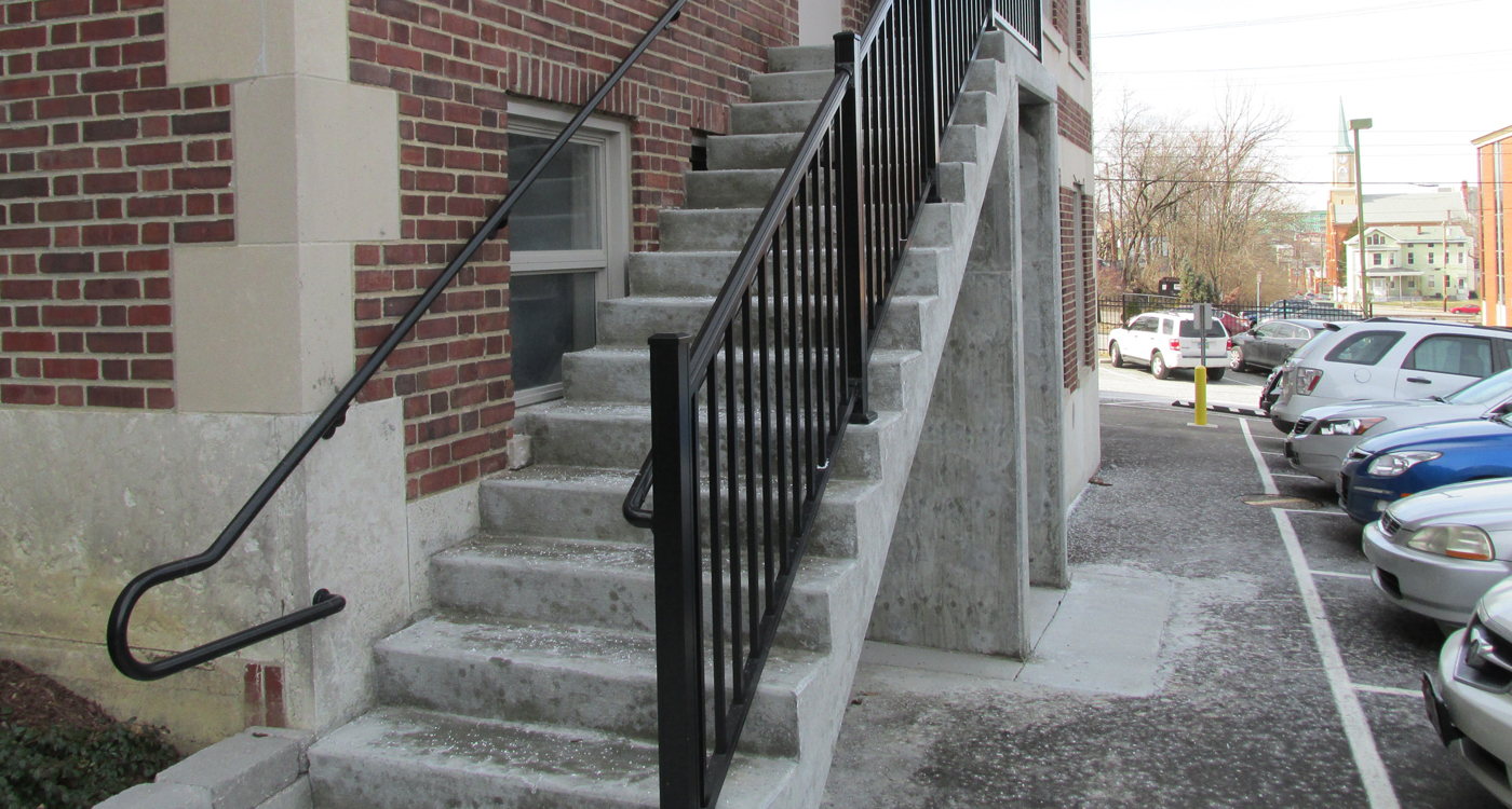 image of decorative handrail installation by Colonial Post and Fence
